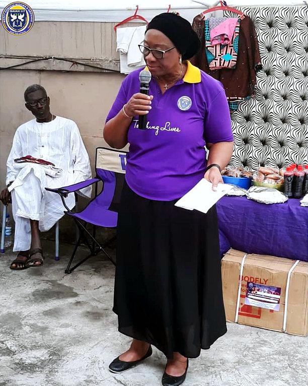 elder woman making a speech