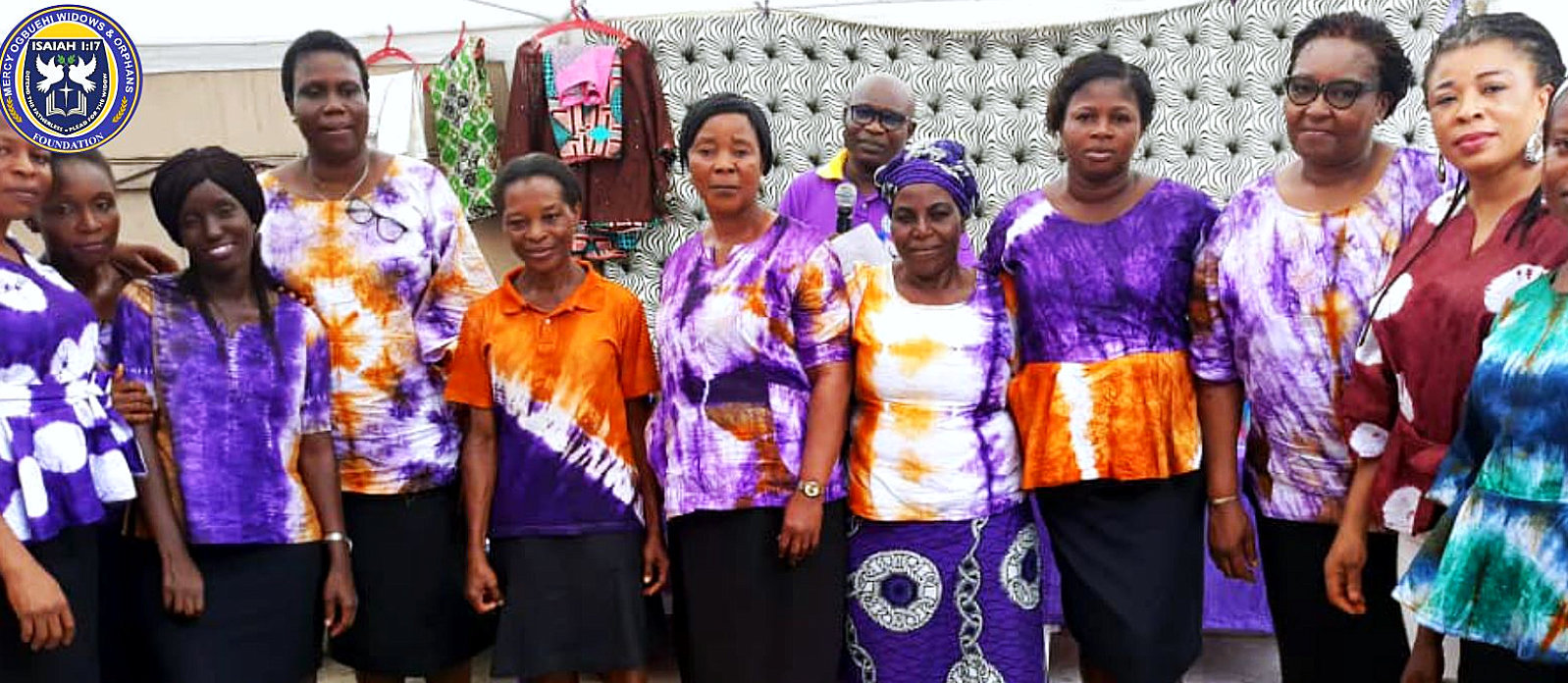 group of elderly in united colored shirts smiling