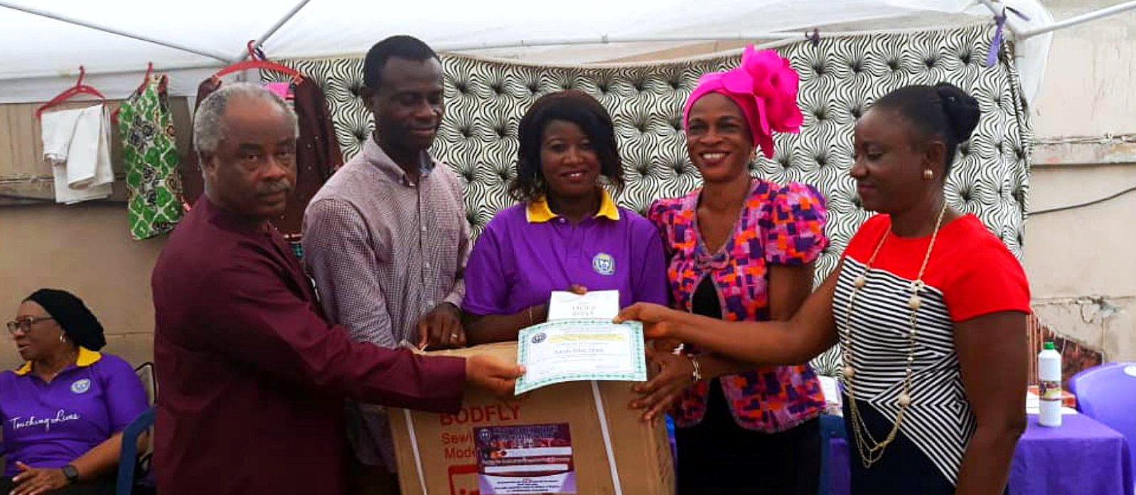 lady given a recognition certicate and award